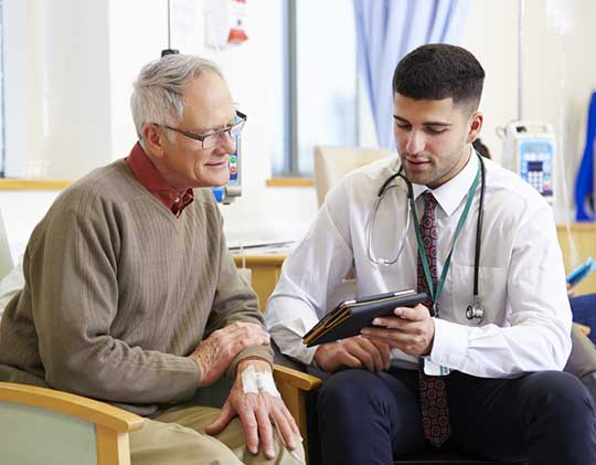 Physician-Talking-to-Patient-During-Chemotherapy